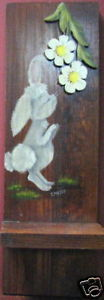 rabbit-sniffing-flowers-on-wood-by-helen-emery